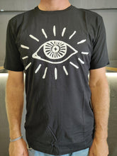 "Load image into Gallery viewer, Fatum Big Eye Tee in Black. Model is wearing an L and is 186cm tall at 85kg. (6'1"" and 14 st)"