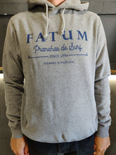 Load image into Gallery viewer, Fatum Fishing Hoodie in Light Grey. Model is wearing a Large and is 186cm and 86kg.
