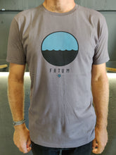 Load image into Gallery viewer, Fatum Telescope Tee in Dark Grey. Model is wearing an L and is 186cm and 86kg.