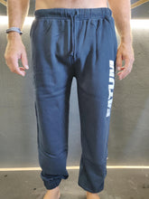 Load image into Gallery viewer, Fatum Chill Pants in Navy. Model is wearing an XL and is 186cm and 86kg.