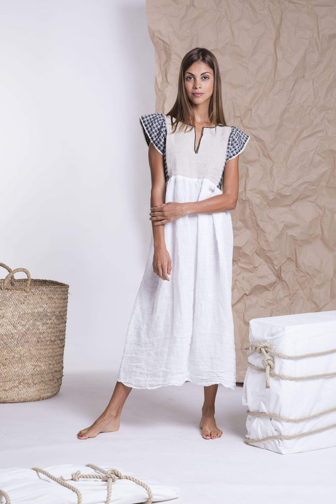 Natural white dress with black embroidery from Nina Leuca