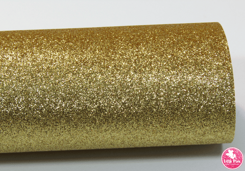 Gold - Fine Glitter Leatherette.  Choose from a full sheet (larger than A4) or half sheet (larger than A5).  Perfect for all your craft projects, including Hair Bows, Headbands, Earrings, Jewellery accessories, Notebook covers, Make-up Bags, Purses & Pencil Cases and many more! Our printed and plain Faux Leathers can be easily cut by hand with scissors, cutting dies or machines such as Sizzix Big Shot.