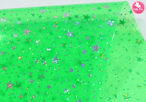 Hologram Stars - Green Transparent PVC.  Choose from a full sheet (larger than A4) or half sheet (larger than A5).  Perfect for all your craft projects, including Hair Bows, Headbands, Earrings, Jewellery accessories, Notebook covers, Make-up Bags, Purses & Pencil Cases and many more! Our printed and plain Faux Leathers can be easily cut by hand with scissors, cutting dies or machines such as Sizzix Big Shot.