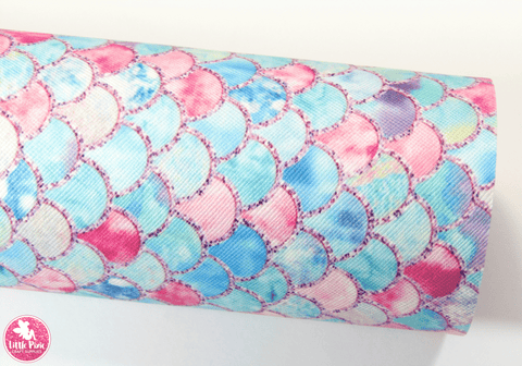 Pink Aqua Blue Mermaid Scales - Canvas Leatherette.  Choose from a full sheet (larger than A4) or half sheet (larger than A5).  Perfect for all your craft projects, including Hair Bows, Headbands, Earrings, Jewellery accessories, Notebook covers, Make-up Bags, Purses & Pencil Cases and many more! Our printed and plain Faux Leathers can be easily cut by hand with scissors, cutting dies or machines such as Sizzix Big Shot.
