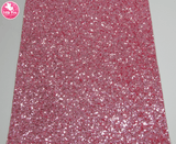 Pink Sapphire - Chunky Glitter Leatherette.  Choose from a full sheet (larger than A4) or half sheet (larger than A5).  Perfect for all your craft projects, including Hair Bows, Headbands, Earrings, Jewellery accessories, Notebook covers, Make-up Bags, Purses & Pencil Cases and many more! Our printed and plain Faux Leathers can be easily cut by hand with scissors, cutting dies or machines such as Sizzix Big Shot.