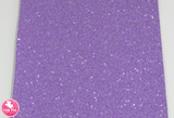 Pixie Sparkle Violet - Chunky Glitter Leatherette.  Choose from a full sheet (larger than A4) or half sheet (larger than A5).  Perfect for all your craft projects, including Hair Bows, Headbands, Earrings, Jewellery accessories, Notebook covers, Make-up Bags, Purses & Pencil Cases and many more! Our printed and plain Faux Leathers can be easily cut by hand with scissors, cutting dies or machines such as Sizzix Big Shot.