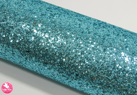 Tiffany Blue - Chunky Glitter Leatherette.  Choose from a full sheet (larger than A4) or half sheet (larger than A5).  Perfect for all your craft projects, including Hair Bows, Headbands, Earrings, Jewellery accessories, Notebook covers, Make-up Bags, Purses & Pencil Cases and many more! Our printed and plain Faux Leathers can be easily cut by hand with scissors, cutting dies or machines such as Sizzix Big Shot.