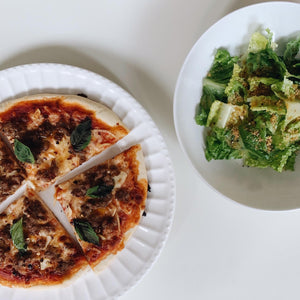 pizza and salad with olive oil