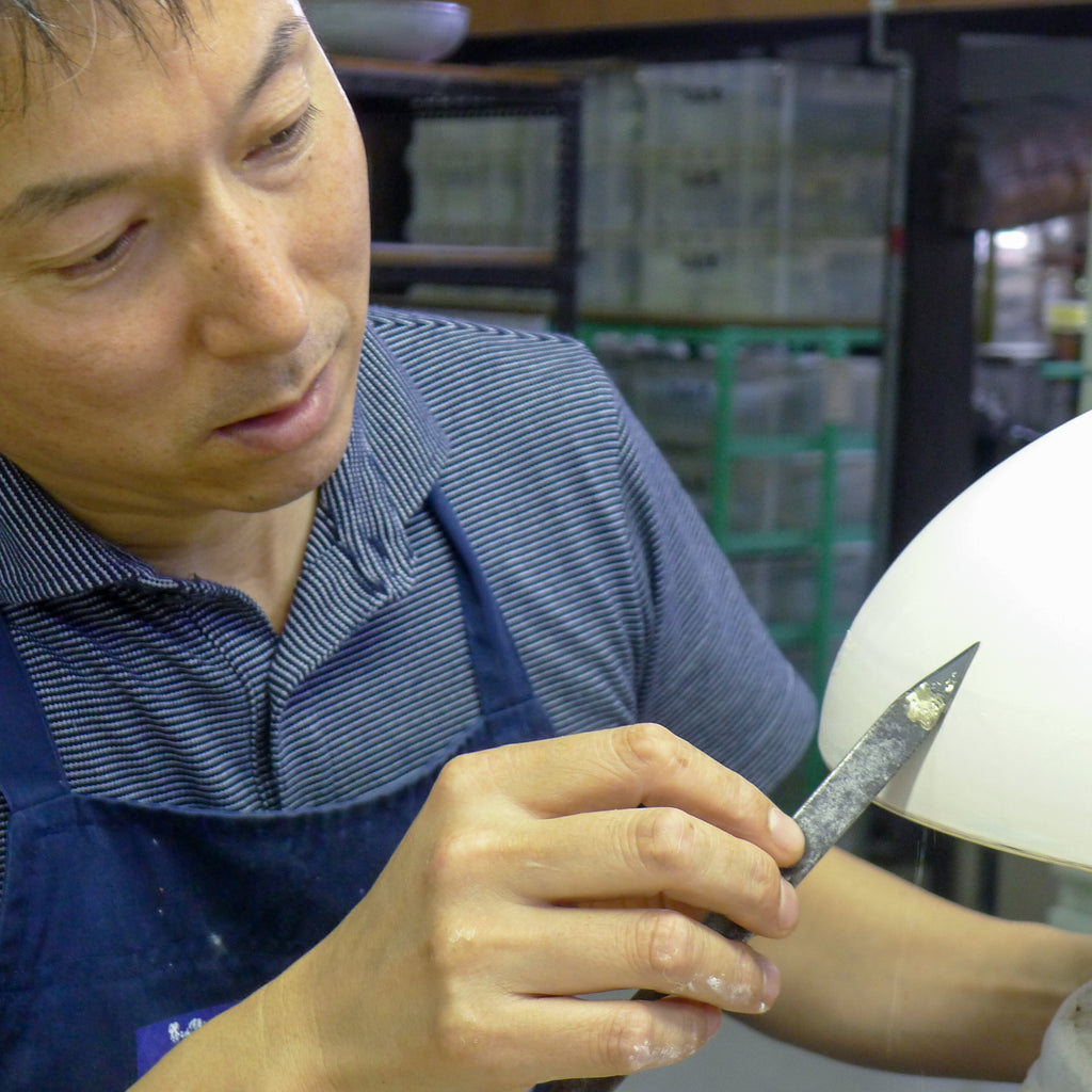 Checking for flaws in Arita Porcelain, Japan