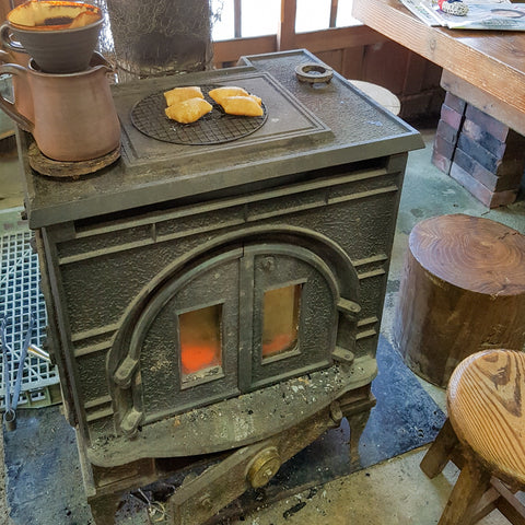 Walnut mochi warming on a wood-fired stove