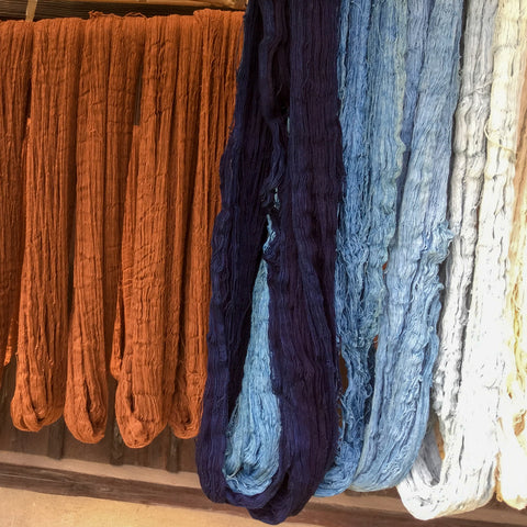 Persimmon and indigo yarns drying in the sun