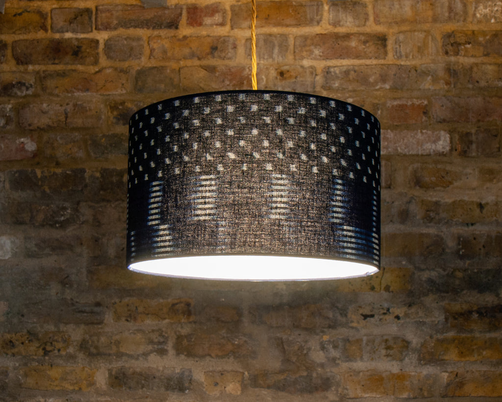 Japanese indigo patterned lampshade on brick wall