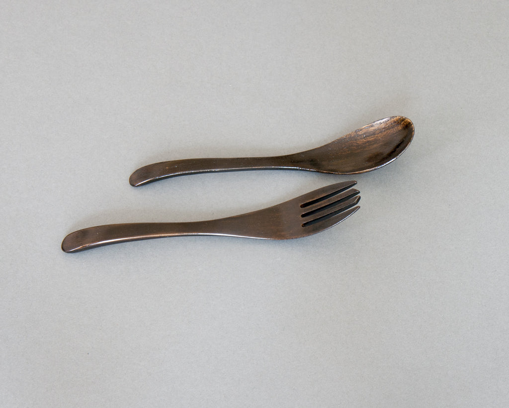 Dark lacquered fork and spoon handmade in Japan