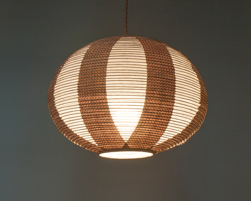 Brown double-layered Japanese paper lamp shade - up lit