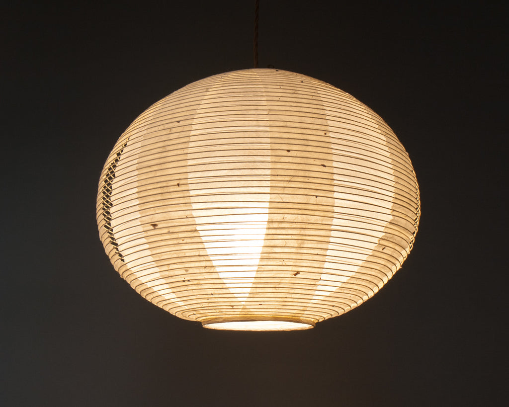 White double-layered Japanese paper lamp shade - up lit
