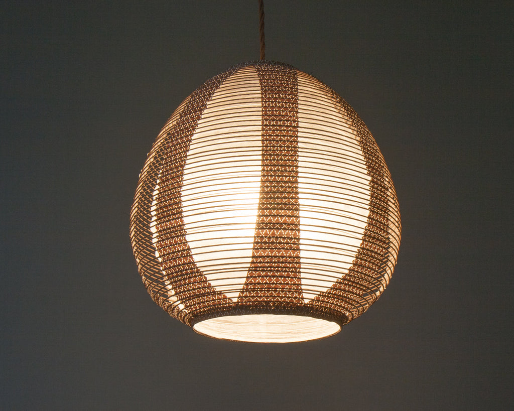 Brown egg-shaped double-layered Japanese paper lamp shade - up lit