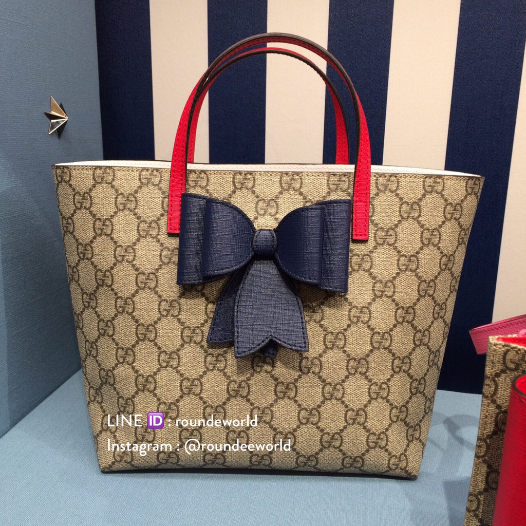 0da52406630 Gucci Children s GG Supreme Bow Tote - Supreme Blue - Roundeworld ...