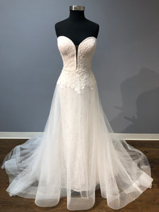 Mikaella Strapless lace bridal gown with detachable organza skirt.
