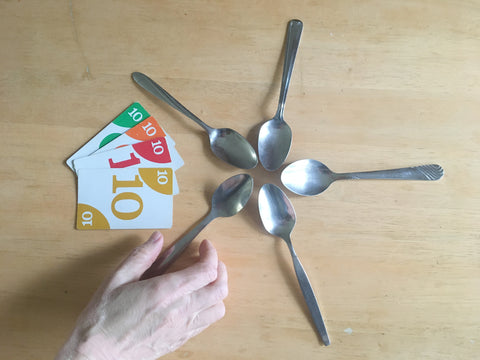 Spoons game layout with 4 of a kind