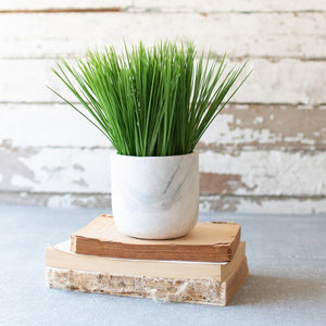 artificial grass in a faux marble pot