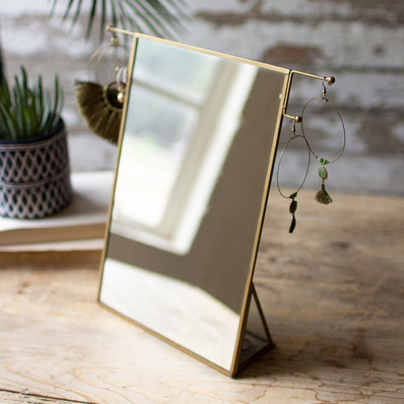 brass framed tabletop mirror with jewelry hooks