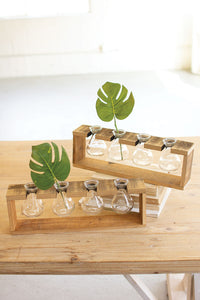 four glass bud vases with a recycled wooden stand