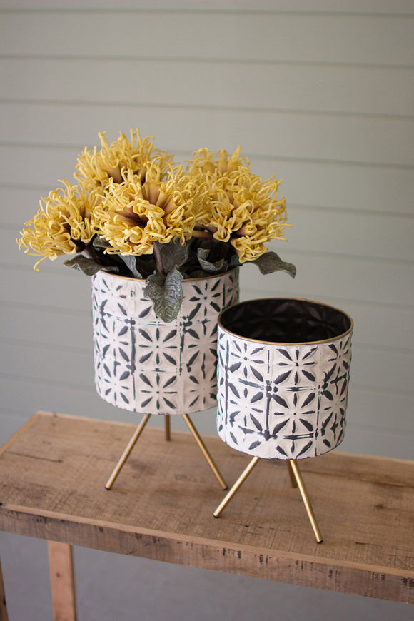 set of two round pressed metal planters on stands