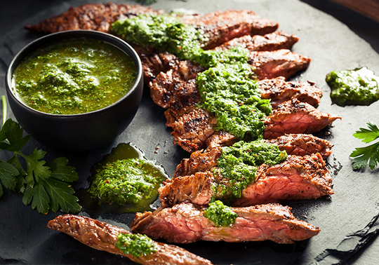 Cajun-Seared Grass-Fed Flank Steak with Spiced Chimichurri Sauce