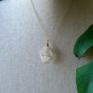 gold wrapped petalite crystal necklace