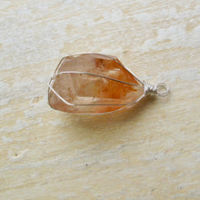 Load image into Gallery viewer, silver wrapped tangerine quartz half point necklace