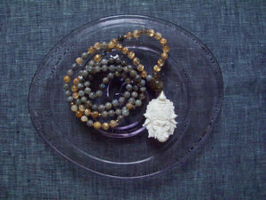 glow and transform rutilated quartz mala