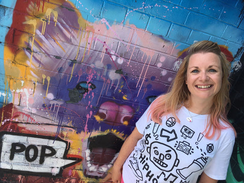 Carla in front of graffiti wall