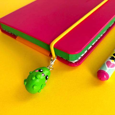 Polymer clay pickle charm on a notebook
