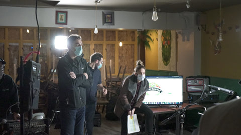 Three people looking at an event being produced