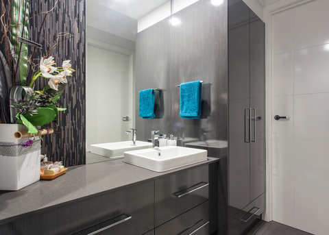 BATHROOM WITH AN ORCHID ARRANGEMENT ON THE COUNTERTOP