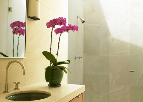 BATHROOM WITH ORCHID ON THE SINK