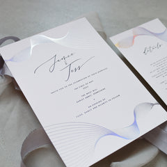 White and Holographic Spiral Foil Wave Invitation Suite