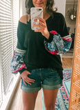 My friend wears casual blouse, loose pullover, sweater and many colors