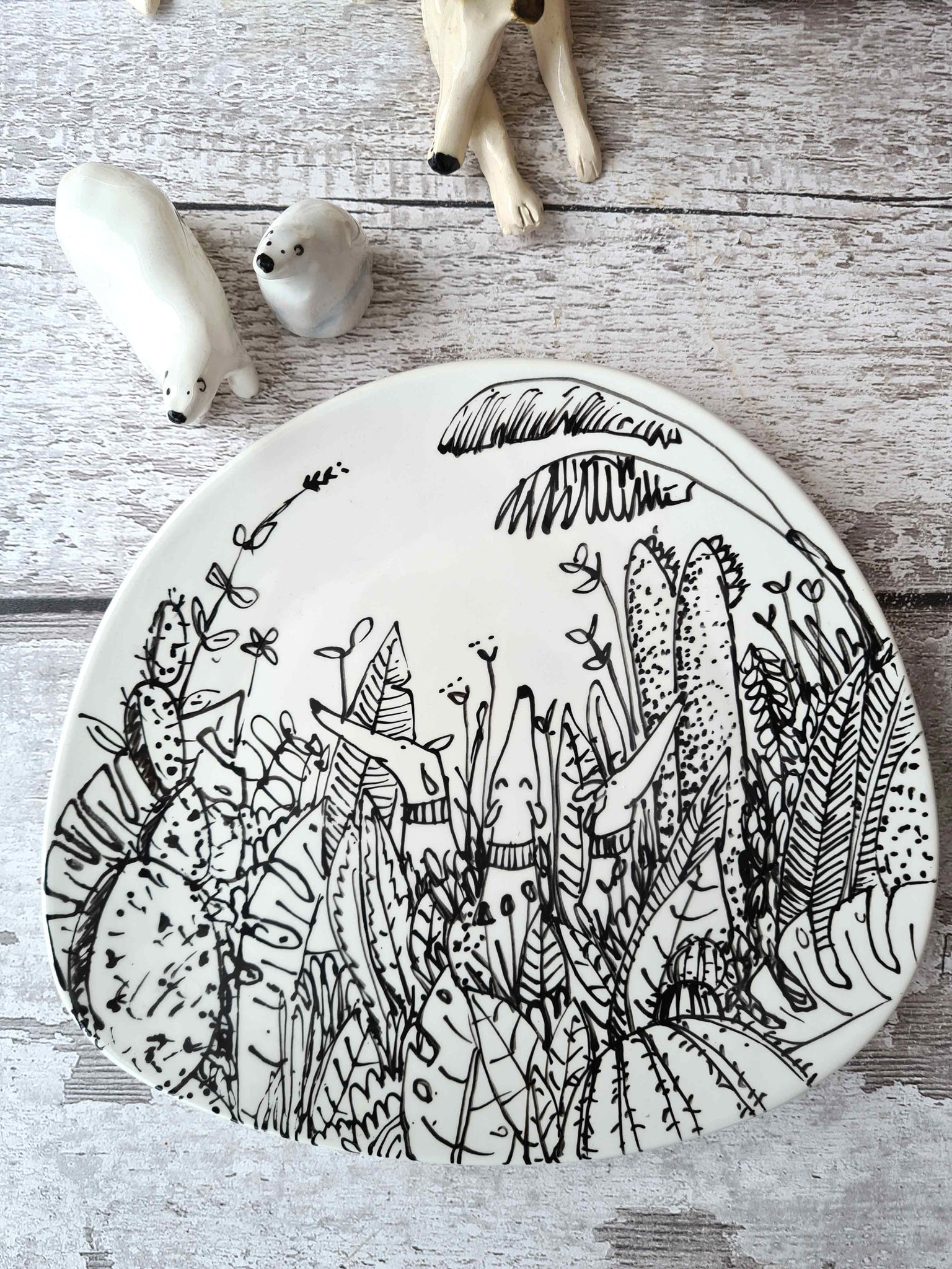 Dogs in plants one of a kind side plate