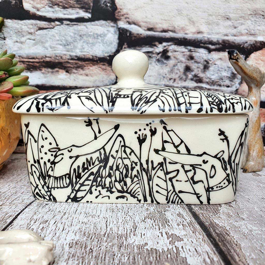 Hand illustrated butter dish Dogs in plants