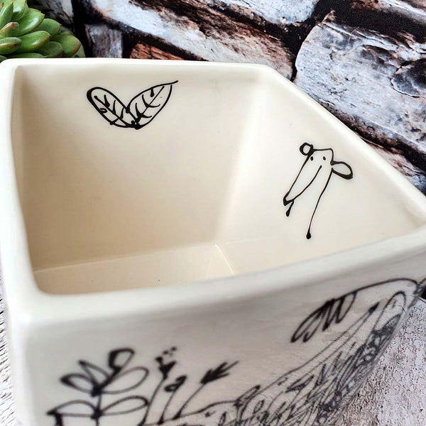 Hand illustrated dogs in plants ceramic cube planter