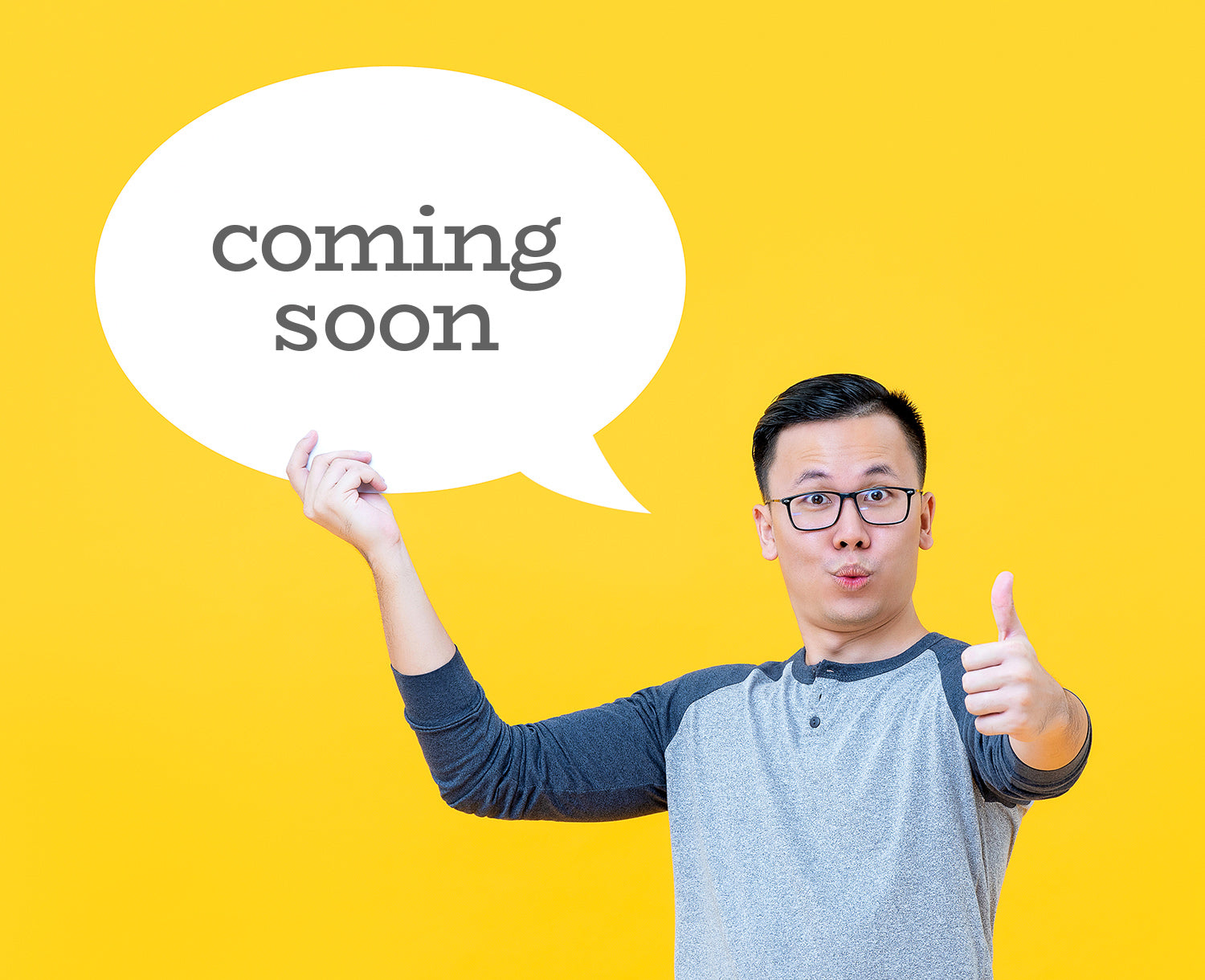 man holding coming soon sign