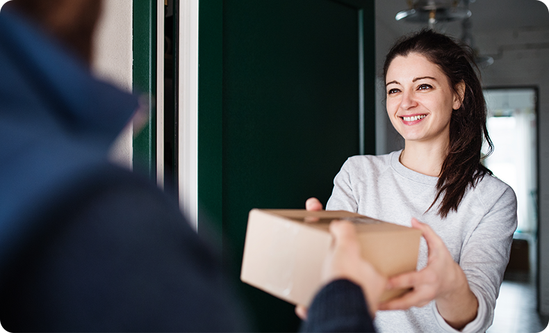 woman receiving package delivery at her door