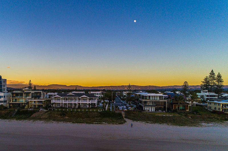 aerial imagery by my drones moonset over beach at golden hour droneography