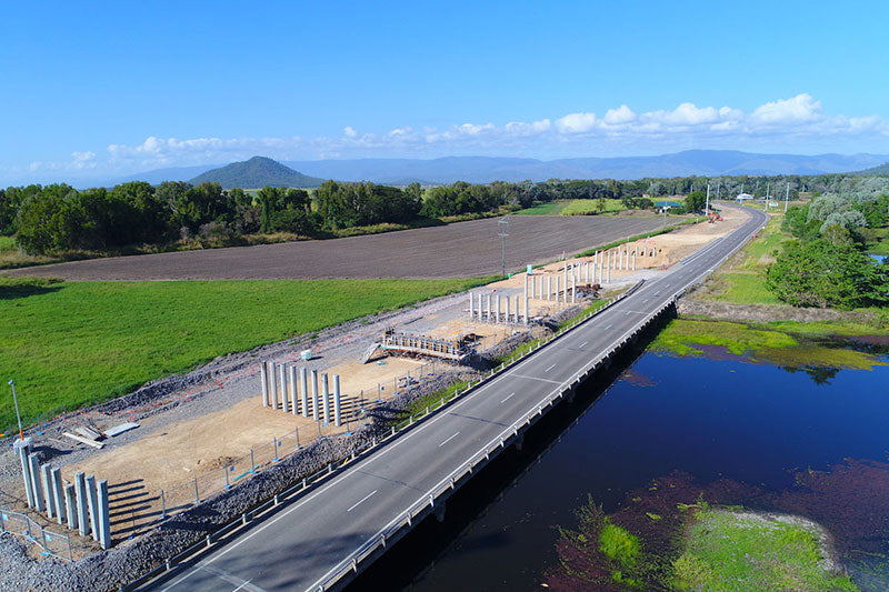aerial imagery by my drones highway bridge construction progress over creek in far north queensland droneography