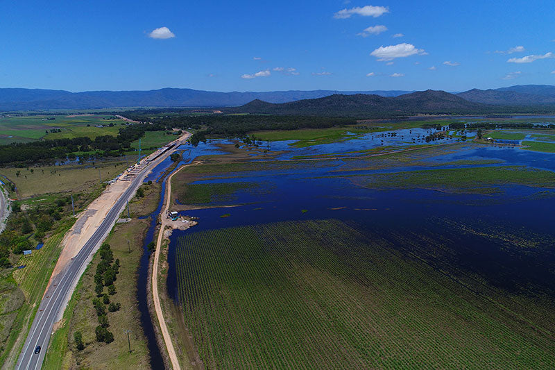 aerial imagery by my drones flooded farm land with highway droneography