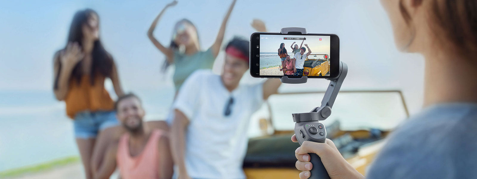 dji osmo mobile 3 taking photo of people