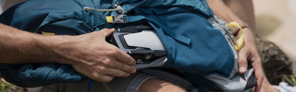 dji mavic air being placed into a backpack