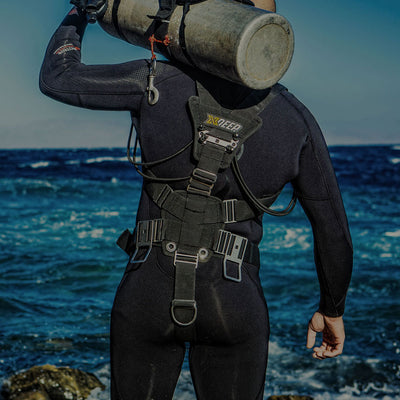 Diver wearing XDeep Stealth 2.0 Classic Redundant Bladder Sidemount System Black