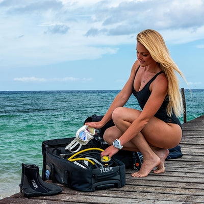 Diver with TUSA Small Roller Bag